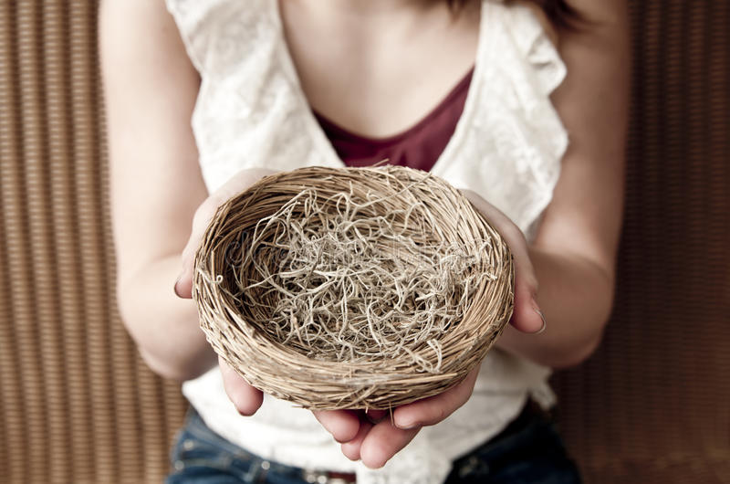 Empty nest. Young girl holding an empty nest royalty free stock photography