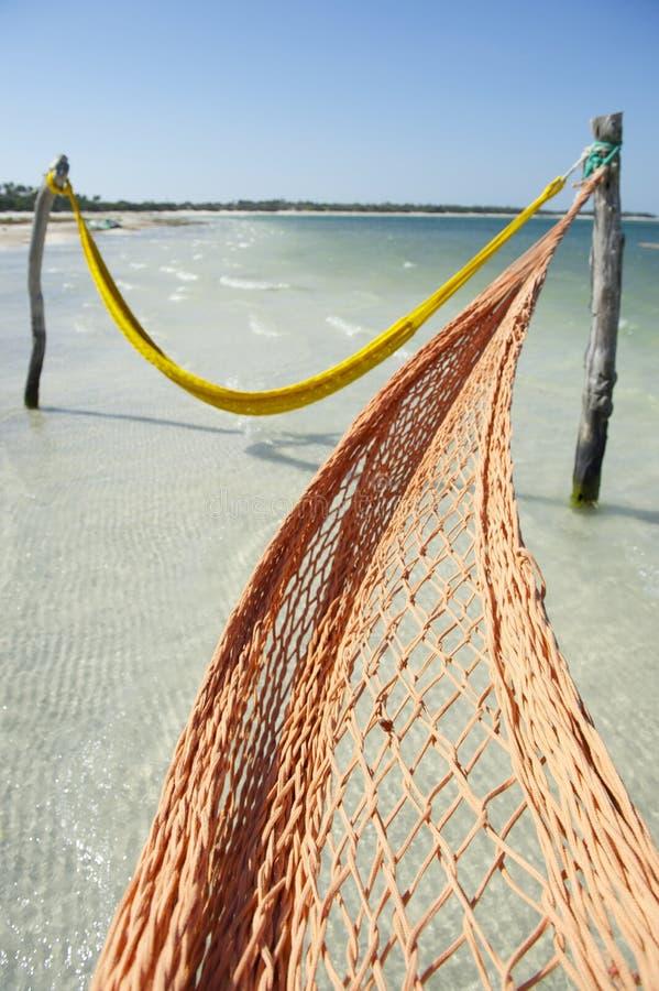 Empty Net Hammocks Tropical Brazilian Beach Sea royalty free stock photo