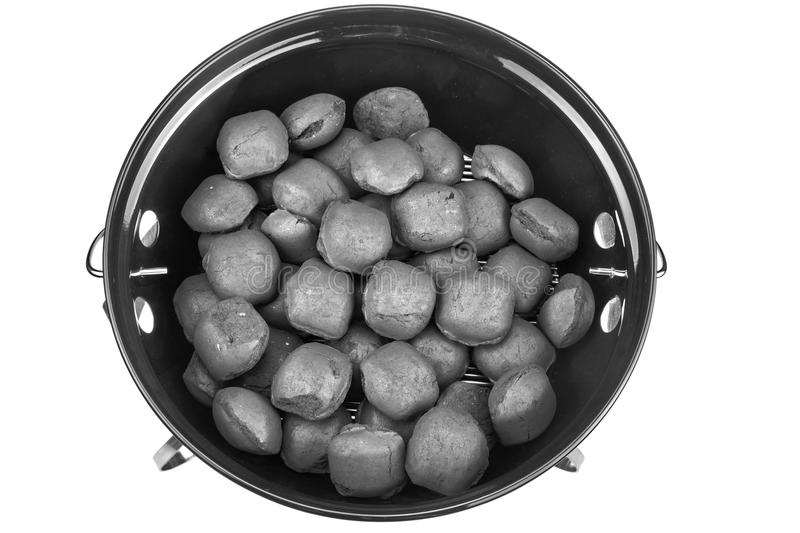 Empty New Clean BBQ Kettle Grill With Charcoal Briquettes Isolated stock photo