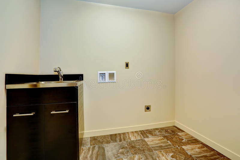 Empty new laundry room with sink and cabinet. stock photo