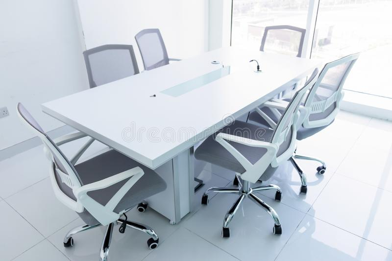 Empty new meeting room with magnificent view from the window. Office chairs and conference table in the office. Business or office stock images