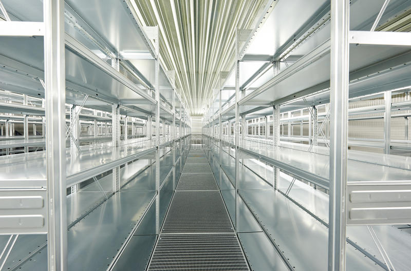 Empty new modern shelves in warehouse. New modern metal warehouse shelves construction stock image
