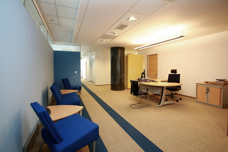 Empty new office. A empty desk in a new office royalty free stock photos