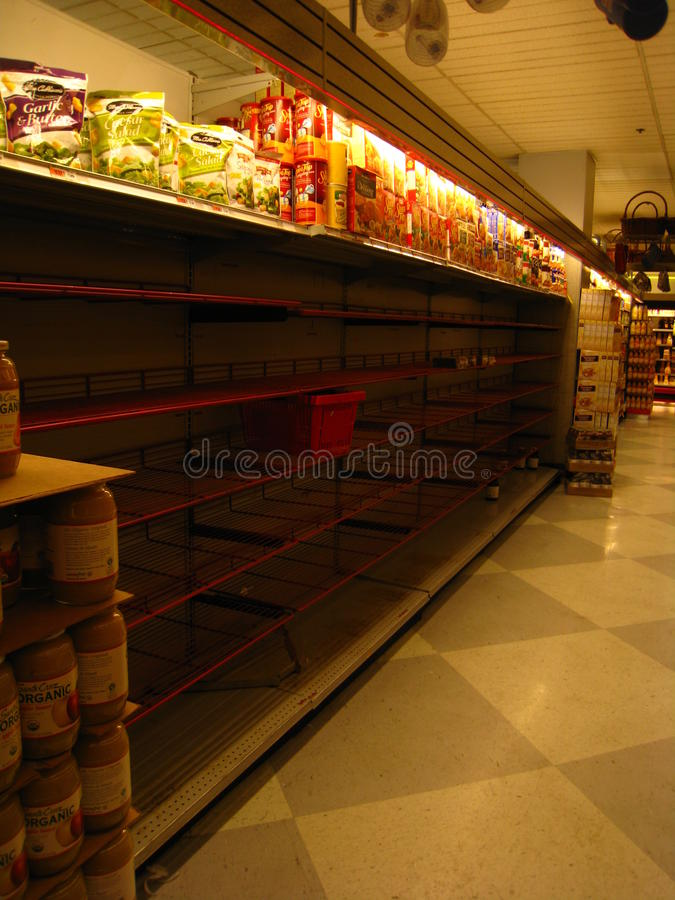 Empty New York supermarket during Hurricane Irene. As Hurricane Irene approached on 8/27/11, New York city supermarket shelves emptied out of essential non stock photos