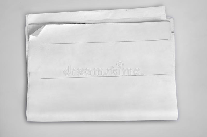 Empty newspaper. On grey background royalty free stock image