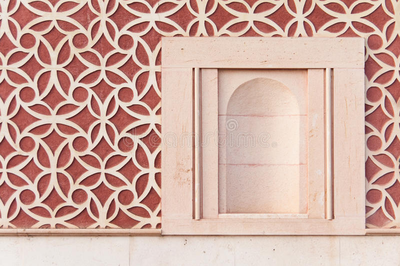 Empty niche of an old house. With a red wall royalty free stock photography