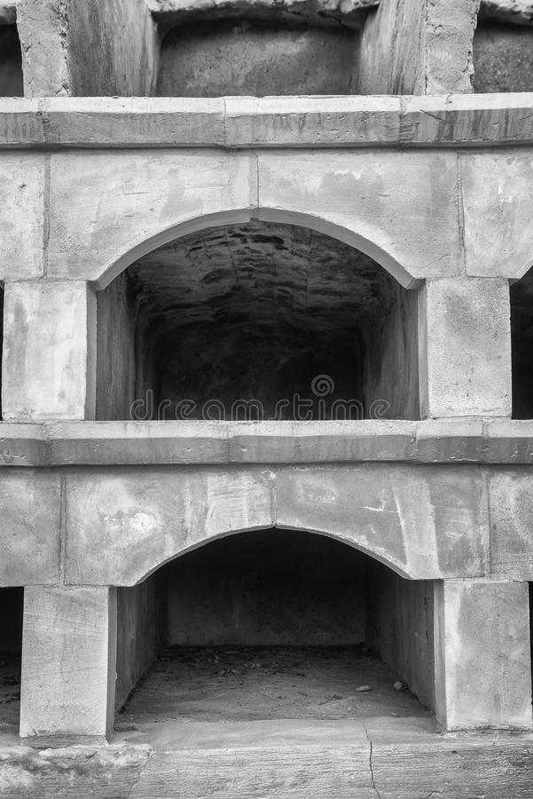 Empty niches. Old empty stone niches on at cemetry stock photography