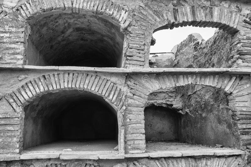 Empty niches. Old empty stone niches on at cemetry stock images