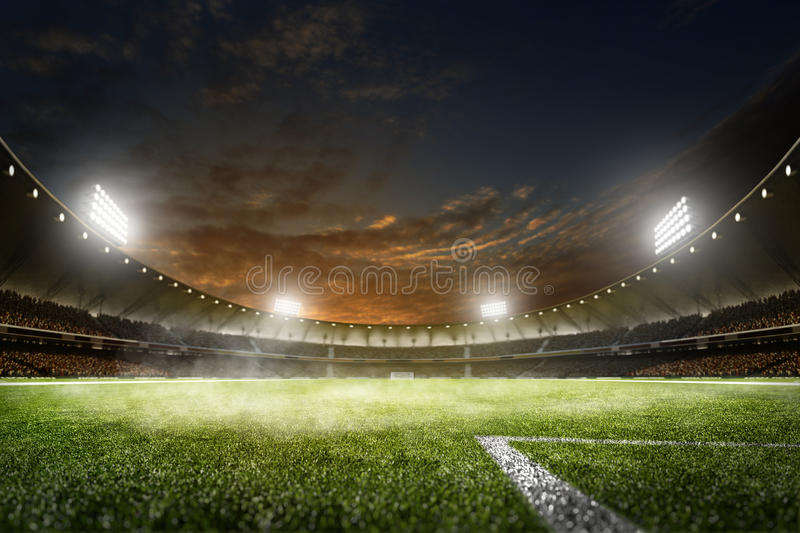 Empty night grand soccer arena in lights. Empty night grand soccer arena in the lights stock photo