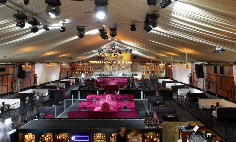 Empty nightclub. Interior with bar, couches and chandelier royalty free stock photography