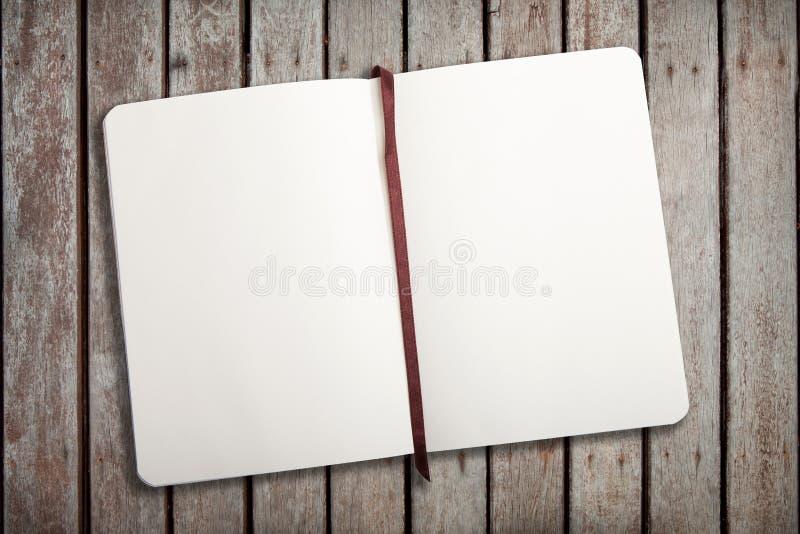 Empty notebook. Opened on woodground royalty free stock photos