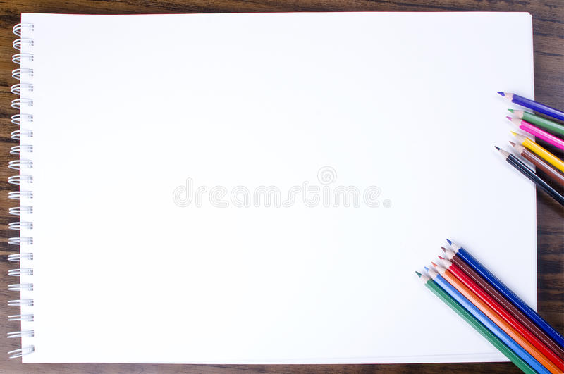 Empty notebook. With pencils over wood table royalty free stock photography