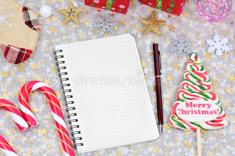 Empty notebook with christmas ornament on table royalty free stock photo