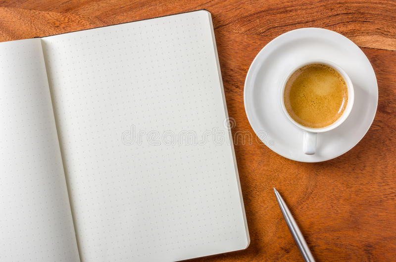 Empty notebook on a desk. An empty notebook on a desk stock images