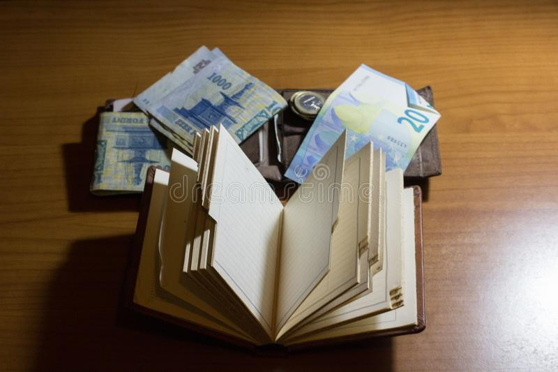 empty notebook with wallet and money on the side on a desk stock image