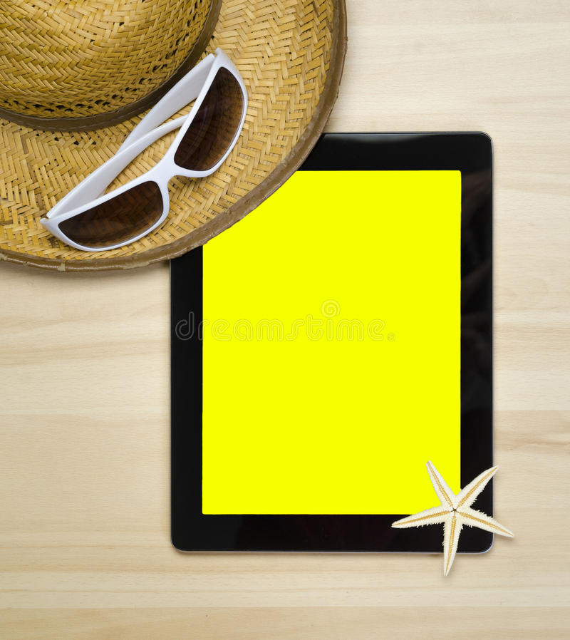 Empty notebook on wooden table surface with beach hat, seashells royalty free stock photo