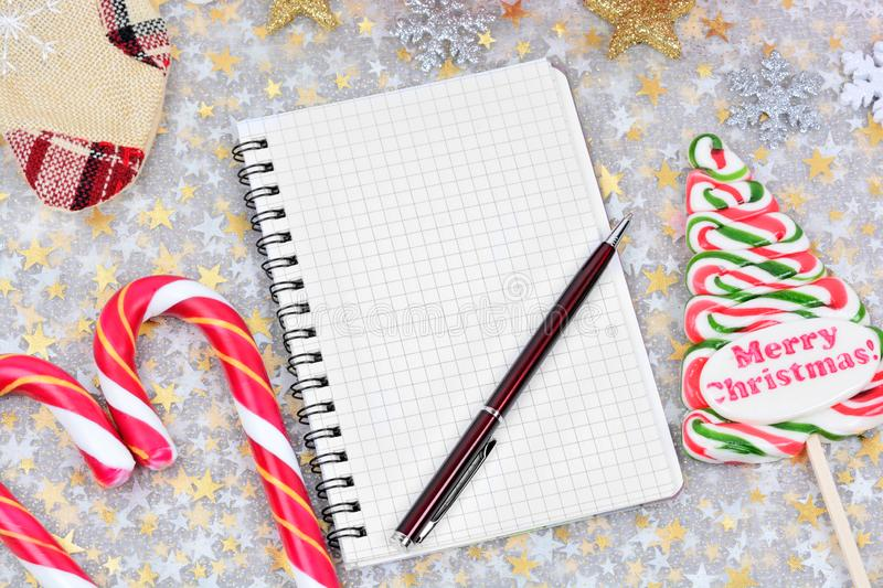 Empty notepad with pen and christmas ornament stock photos