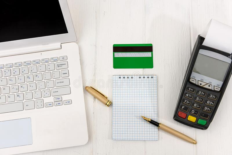 Empty notepad with terminal, credit card and laptop stock photo