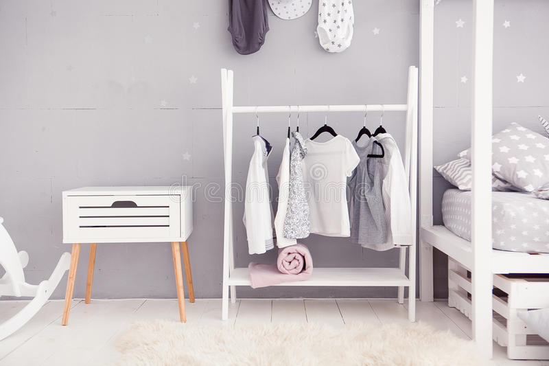 Empty nursery room with clear wall, toys and wooden horse royalty free stock photography