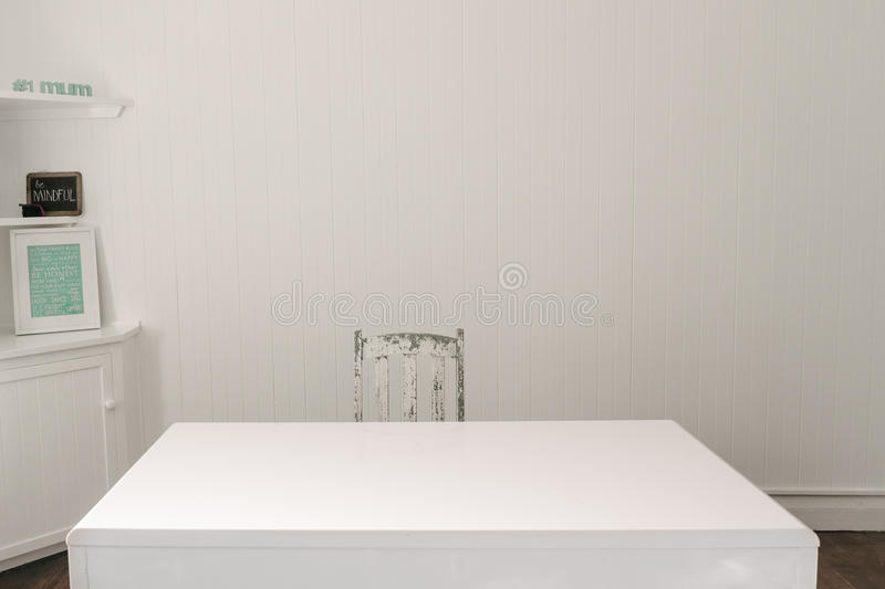 Empty office desk with timber vintage chair stock photos