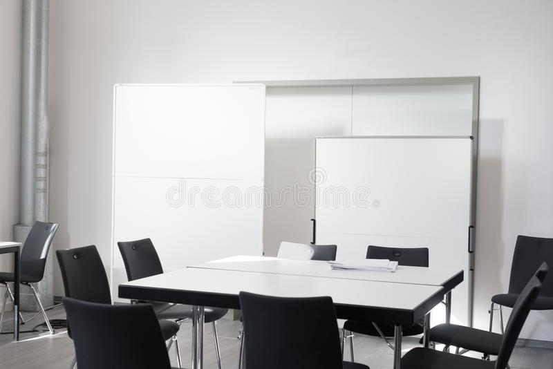 Empty office meeting room with chair, table white board royalty free stock photography
