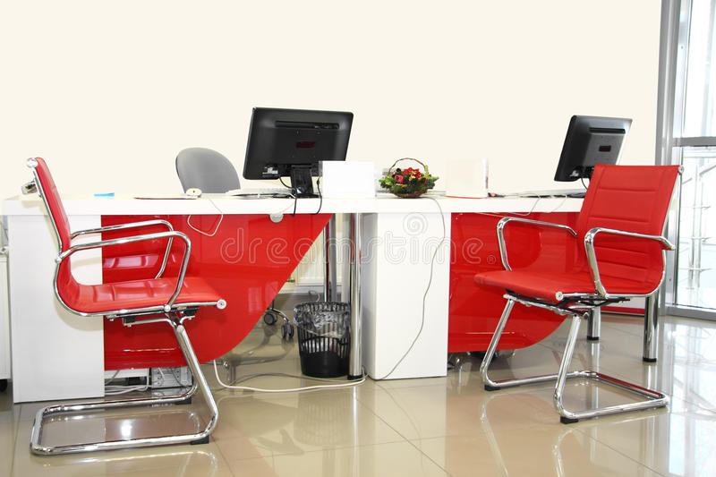 Empty office room. The image of empty office room with red and white chairs and table stock image