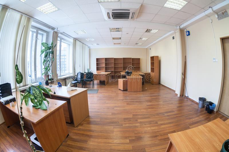 Empty office space with tables, cabinets and flowers, nobody. Wide angle view stock photography