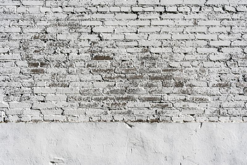 Empty Old Brick Wall Texture. Painted Distressed Wall Surface. Grungy Wide Brickwall. Shabby Building Facade With Damaged Plaster stock photos