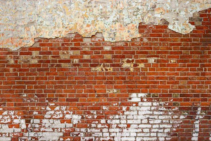 Empty Old Brick Wall Texture. Painted Distressed Wall Surface. Grunge Red Stonewall Background. Shabby Building Facade With Damage royalty free stock photos