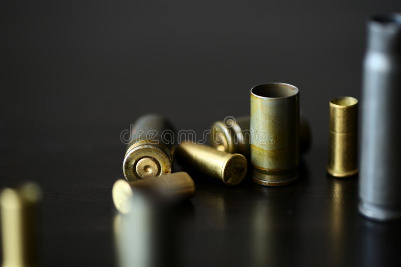 Empty old bullet cartridges on a dark background. Close up royalty free stock images
