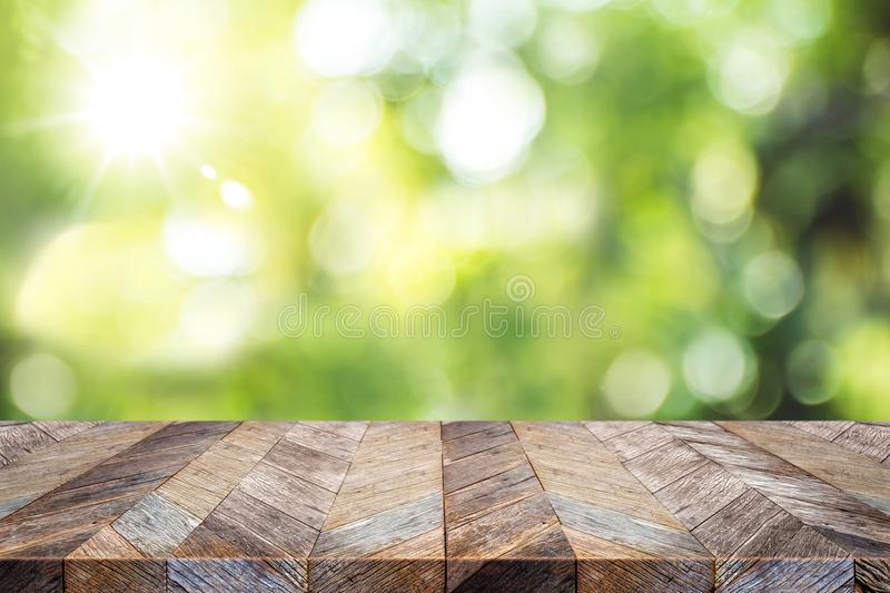 Empty old grunge wood plank table top with blur green tree in pa royalty free stock photos