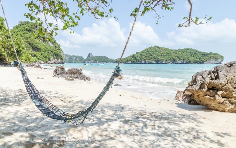 Empty old hammock for relaxation under coconut palm trees on sandy tropical beach at Wua Ta Lap island beach in Angthong Islands N. Ational Marine Park Surat royalty free stock photos