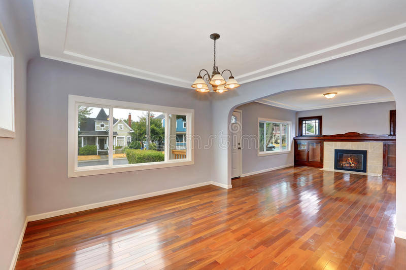 Empty Old house interior. Entryway with hardwood floor. And lavender walls. Living room. Northwest, USA stock image