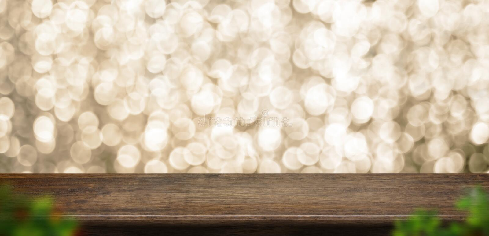Empty old rustic dark wood table top with blur sparkling gold bokeh and blur leaf abstract background,panoramic banner for display. Or montage of product royalty free stock photos