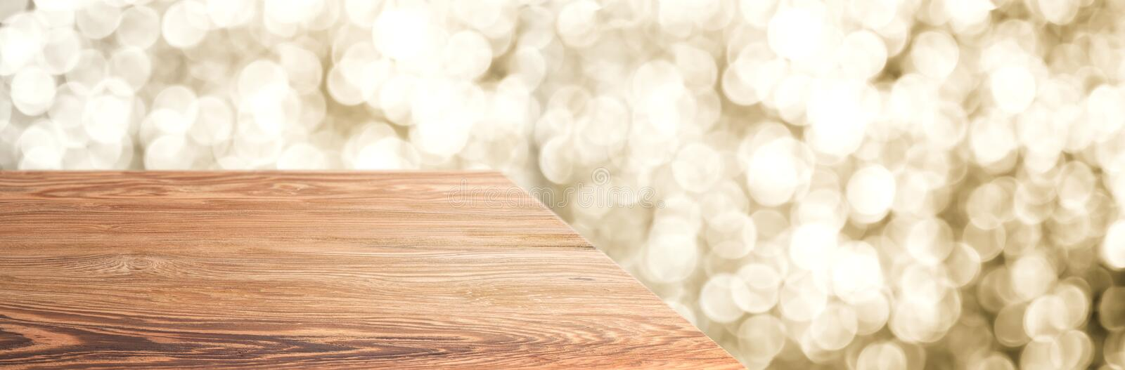 Empty old rustic wood table top with blur sparkling gold bokeh abstract background,panoramic banner for display or montage of. Product,Holiday seasonal concept royalty free stock images