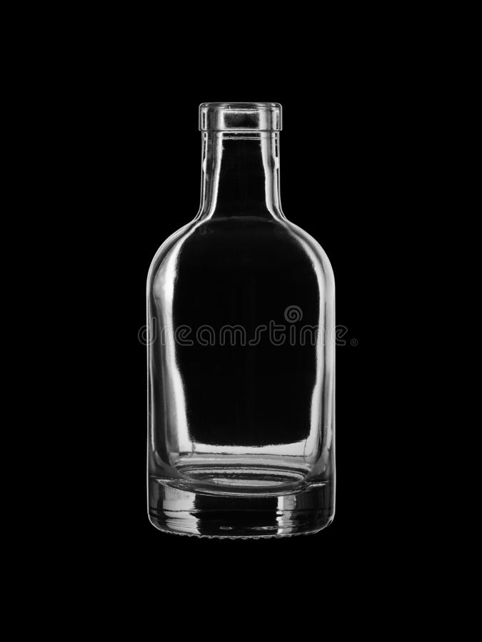 Empty open bottle for alcoholic beverages, isolated on black background.  stock photos
