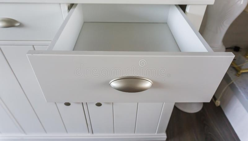 Empty open modern white wooden drawer with nothing inside so empty space to put whatever you like. A Empty open modern white wooden drawer with nothing inside so stock images