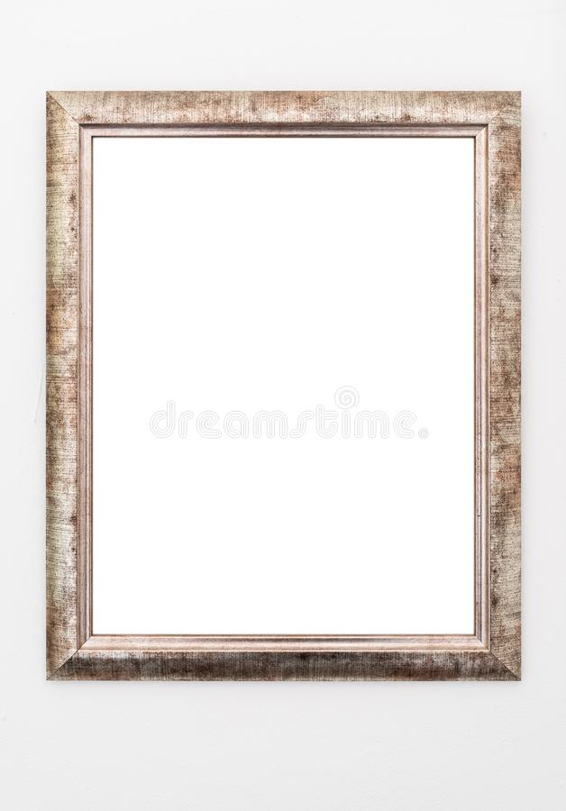 Empty ornate picture frame hanging on wall royalty free stock photos