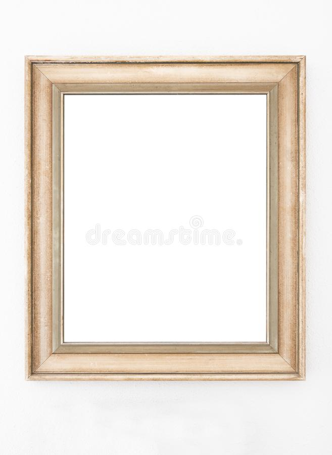 Empty ornate picture frame hanging on wall royalty free stock photography