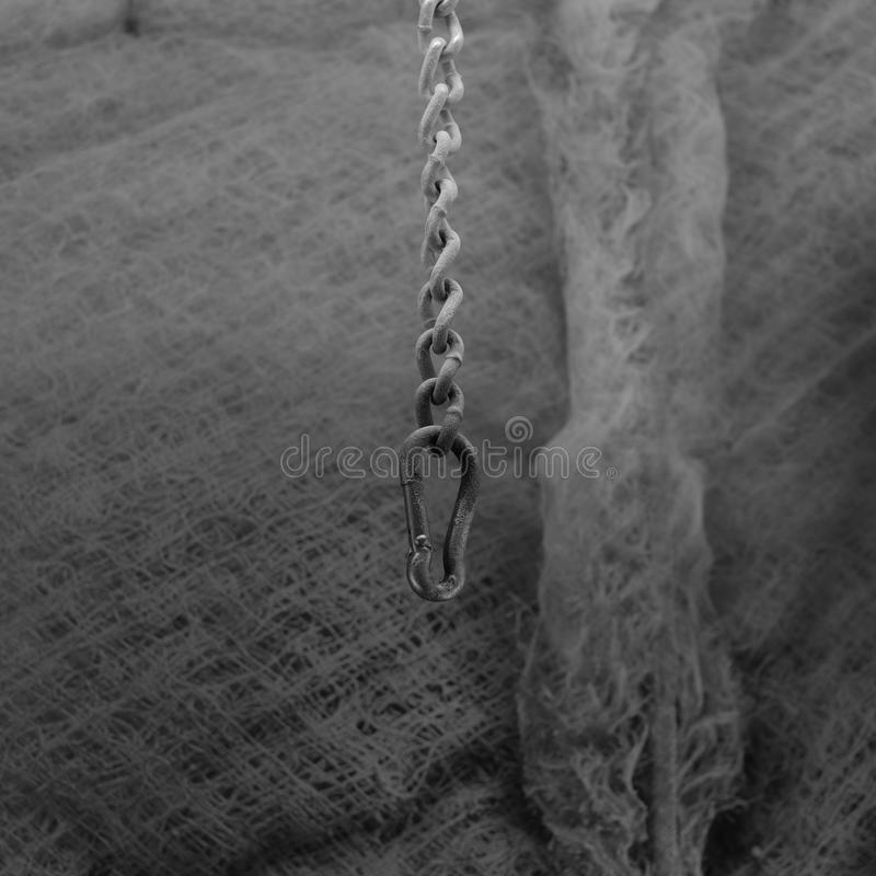 Empty Painting chain for Guitars. An empty chain for holding items being painted hangs holding nothing stock photo