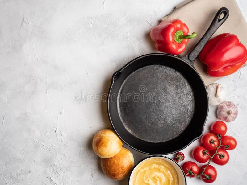 Empty pan on a concrete surface, top view. stock images