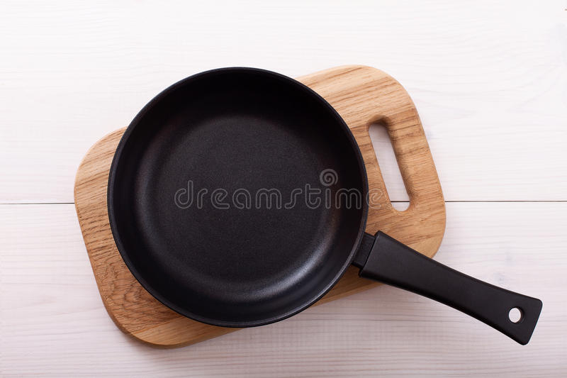 Empty pan on wooden deck table with tablecloth stock photos
