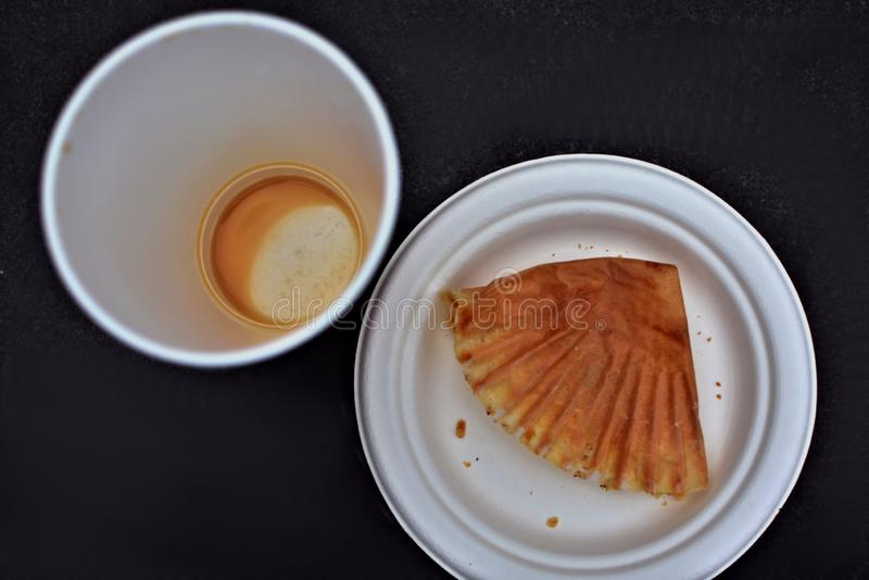 Empty coffee cup and plate overhead view royalty free stock photo