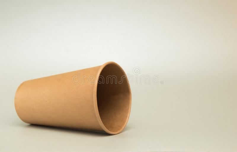 Empty paper cup for coffee lies on its side on white background stock photos
