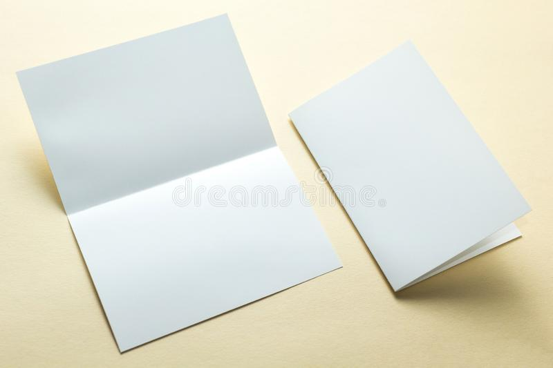 Empty paper flyers, business cards, brochures on a yellow background, layout. Space for text.  stock photo