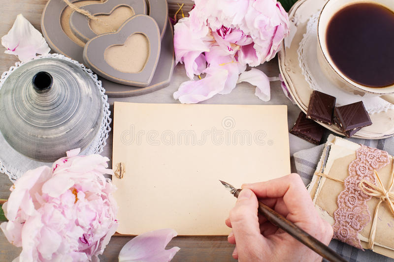 Empty Paper, Old Letters, Post Cards and Male Hand. Nostalgic Retro Background stock photos