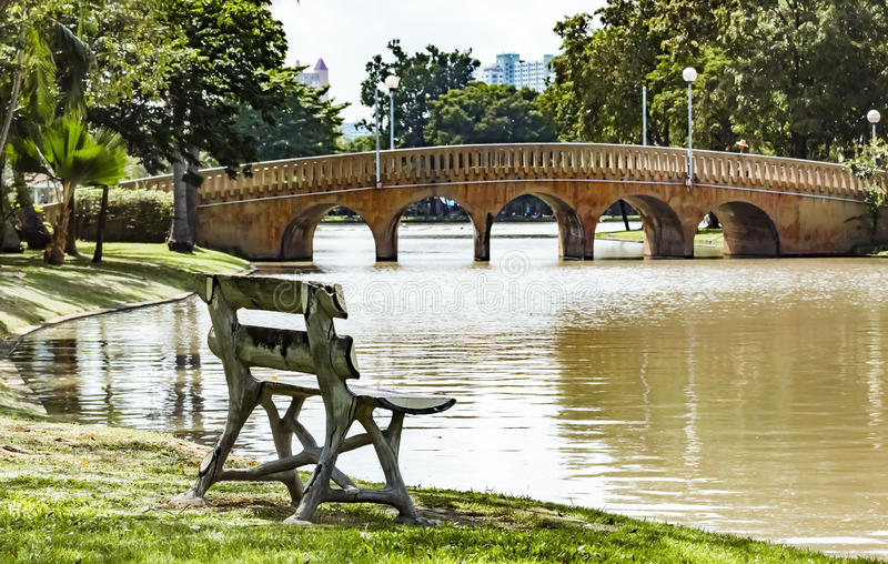 Empty Park Bench In The Background The Stone Bridge At ...
