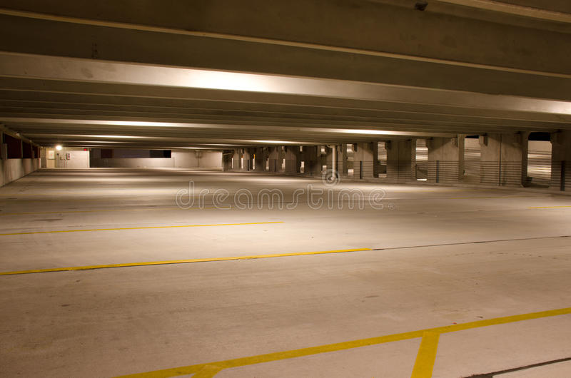Empty parking building level at night