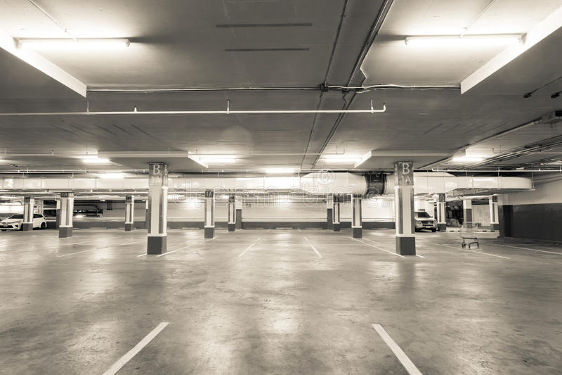Empty parking garage underground interior in apartment or in su. Permarket royalty free stock photos