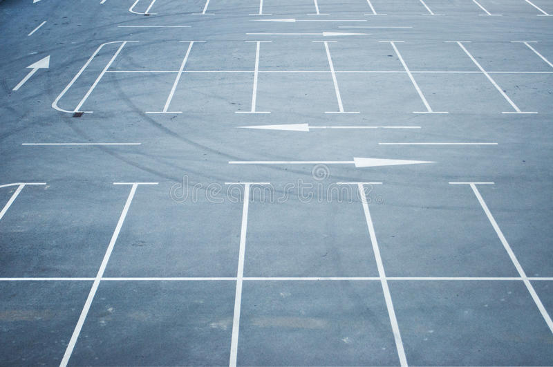 Empty parking lot. Spaces await commuters royalty free stock photography